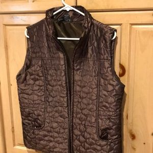 Brown vest, can be gathered in back for shape